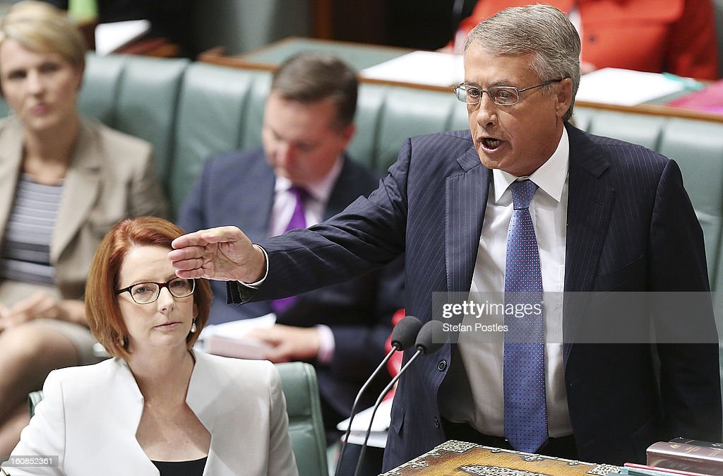 Treasurer <a gi-track='captionPersonalityLinkClicked' href=/galleries/search?phrase=Wayne+Swan&family=editorial&specificpeople=4582809 ng-click='$event.stopPropagation()'>Wayne Swan</a> during House of Representatives question time at Parliament House on February 7, 2013 in Canberra, Australia. Parliament resumes for the first sitting of 2013 this week, just days after Prime Minister Gillard, announced a federal election date of September 14, 2013.