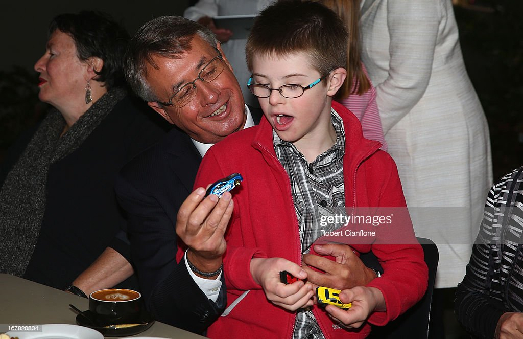 Treasurer Wayne Swan meets a member of the disability community after a press conference at the Commonwealth Parliamentary Office on May 1, 2013 in Melbourne, Australia. Gillard has announced that the Federal Government will increase the Medicare levy on income tax from 1.5 to two percent to help fund the National Disability Insurance Scheme (NDIS). The levy will begin on July 1, 2014 and is expected to raise around $3.2 billion annually towards the NDIS which is expected to cost $8 billion per year.