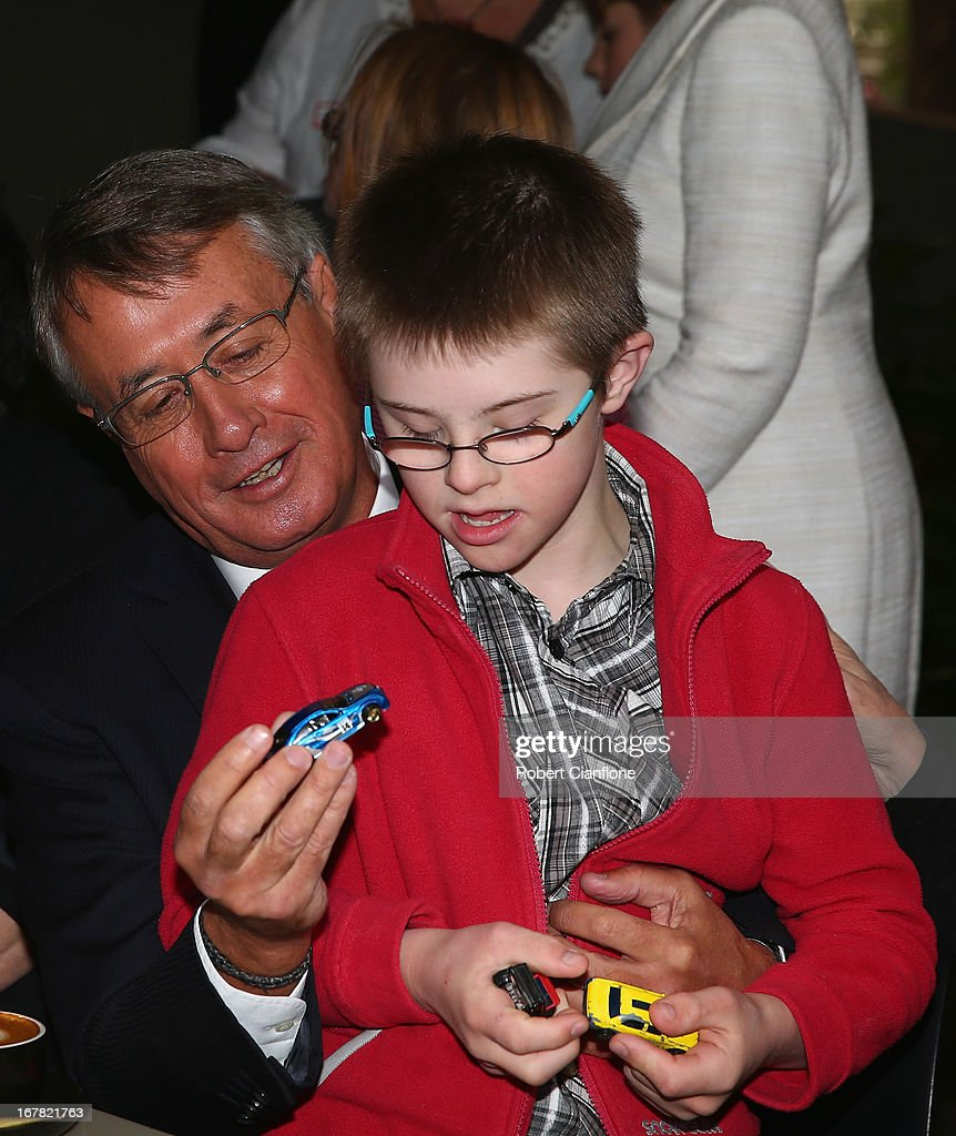 Treasurer <a gi-track='captionPersonalityLinkClicked' href=/galleries/search?phrase=Wayne+Swan&family=editorial&specificpeople=4582809 ng-click='$event.stopPropagation()'>Wayne Swan</a> meets a member of the disability community after a press conference at the Commonwealth Parliamentary Office on May 1, 2013 in Melbourne, Australia. Gillard has announced that the Federal Government will increase the Medicare levy on income tax from 1.5 to two percent to help fund the National Disability Insurance Scheme (NDIS). The levy will begin on July 1, 2014 and is expected to raise around $3.2 billion annually towards the NDIS which is expected to cost $8 billion per year.
