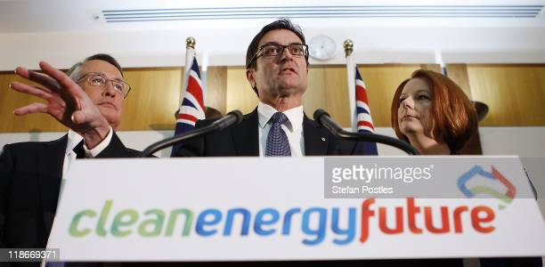 Treasurer Wayne Swan Minister for Climate Change and Energy Efficiency Greg Combet and Australian Prime Minister Julia Gillard talk during the...