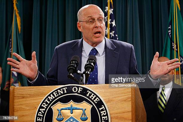 S Treasury Secretary Henry Paulson holds a press conference to announce a framework to help prevent foreclosures and alieviate the impact on the...