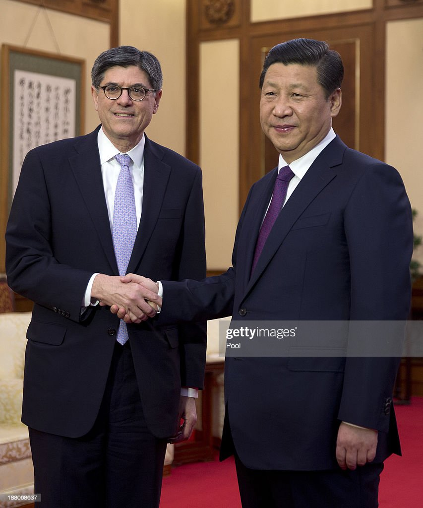 U.S. Treasury Secretary <a gi-track='captionPersonalityLinkClicked' href=/galleries/search?phrase=Jack+Lew&family=editorial&specificpeople=2745013 ng-click='$event.stopPropagation()'>Jack Lew</a> (L) and Chinese President <a gi-track='captionPersonalityLinkClicked' href=/galleries/search?phrase=Xi+Jinping&family=editorial&specificpeople=2598986 ng-click='$event.stopPropagation()'>Xi Jinping</a> (R) shake hands ahead of a meeting at the Diaoyutai State Guesthouse on November 15, 2013 in Beijing, China.