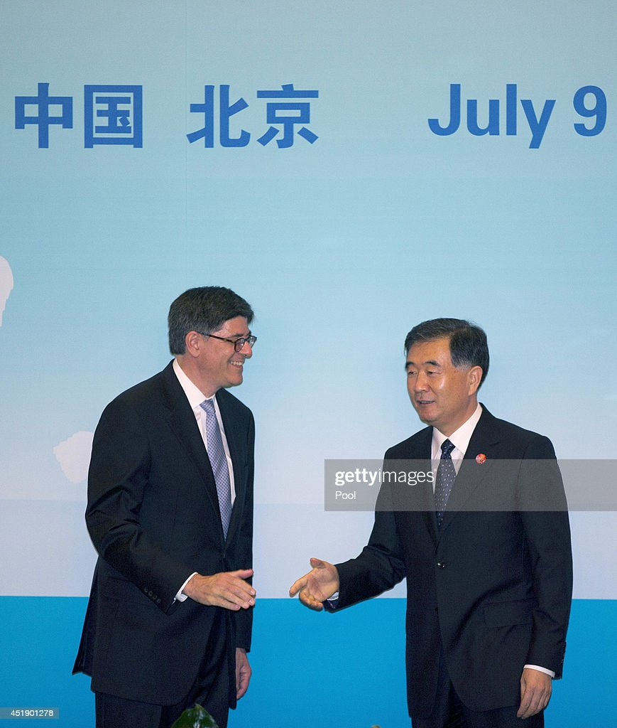 U.S. Treasury Secretary <a gi-track='captionPersonalityLinkClicked' href=/galleries/search?phrase=Jack+Lew&family=editorial&specificpeople=2745013 ng-click='$event.stopPropagation()'>Jack Lew</a>, left, chats with Chinese Vice Premier Wang Yang as they arrive for the 6th China-U.S. Security & Economic Dialogue at the Diaoyutai State Guesthouse July 9, 2014 in Beijing, China. U.S. diplomats are in China attending the strategic dialogue with regional security as a key topic.