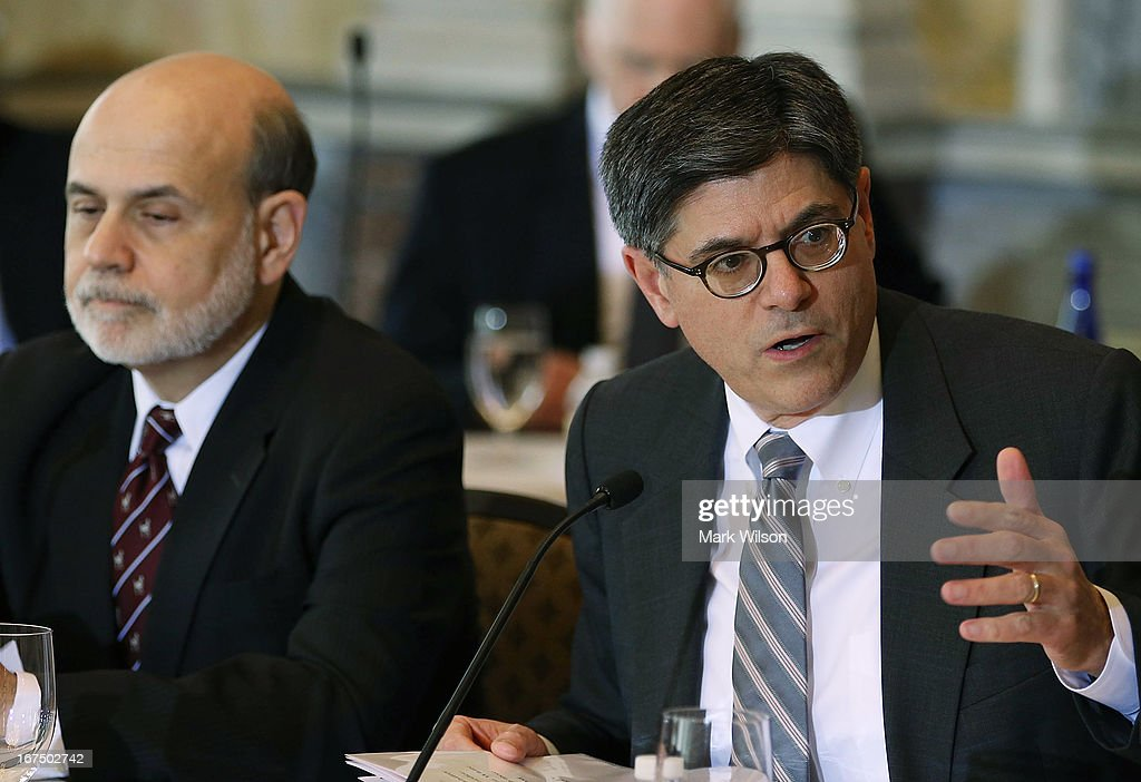 Treasury Secretary <a gi-track='captionPersonalityLinkClicked' href=/galleries/search?phrase=Jack+Lew&family=editorial&specificpeople=2745013 ng-click='$event.stopPropagation()'>Jack Lew</a> (R) speaks while Federal Reserve Chairman <a gi-track='captionPersonalityLinkClicked' href=/galleries/search?phrase=Ben+Bernanke&family=editorial&specificpeople=568098 ng-click='$event.stopPropagation()'>Ben Bernanke</a> listens during an open session of the Financial Stability Oversight Council at the Treasury Department, April 25, 2013 in Washington, DC. The session was held to discuss the financial markets and emerging threats to financial stability, and make relevant recommendations.
