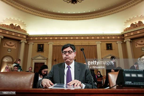 Treasury Secretary Jack Lew takes his seat to testify before the House Ways and Means Committee on the president's fiscal year 2014 budget proposal...