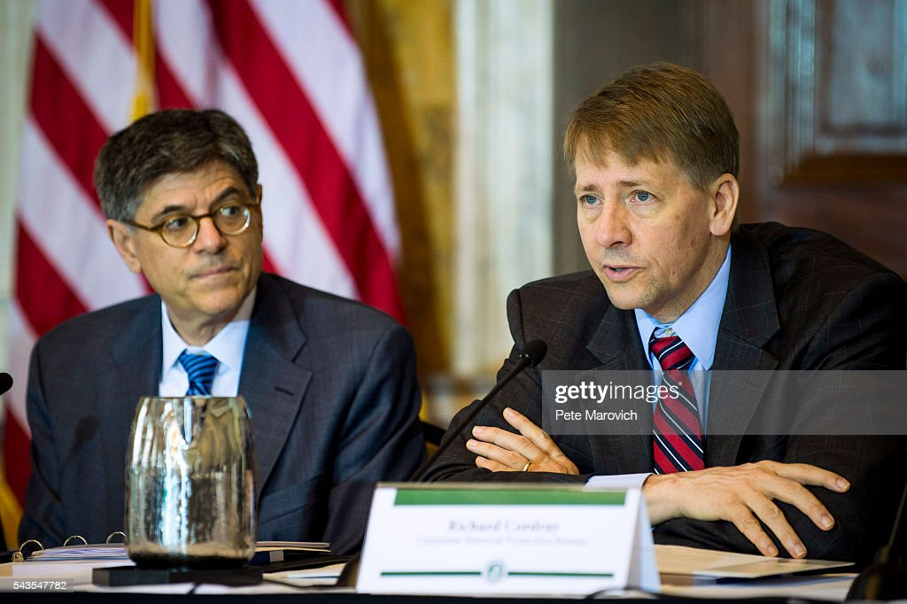 Treasury Secretary Jacob J. Lew looks on as Director of the Consumer Financial Protection Bureau, Richard Cordray delivers remarks during a public meeting of the Financial Literacy and Education Commission at the United States Treasury on June 29, 2016 in Washington, DC. The agenda focused on financial education and investment advice, as well as the intersection of financial education and legal aid.