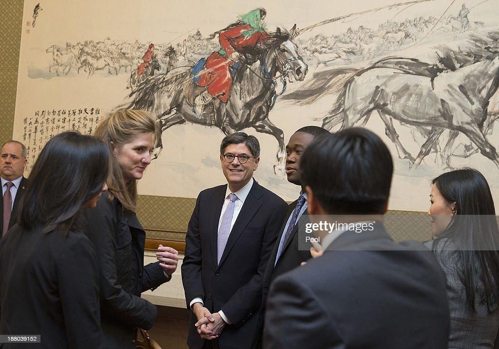 U.S. Treasury Secretary Jacob Lew (C) and his delegation arrive for a meeting with Vice Premier Wang Yang of China at the Diaoyutai State Guesthouse on November 15, 2013 in Beijing, China.