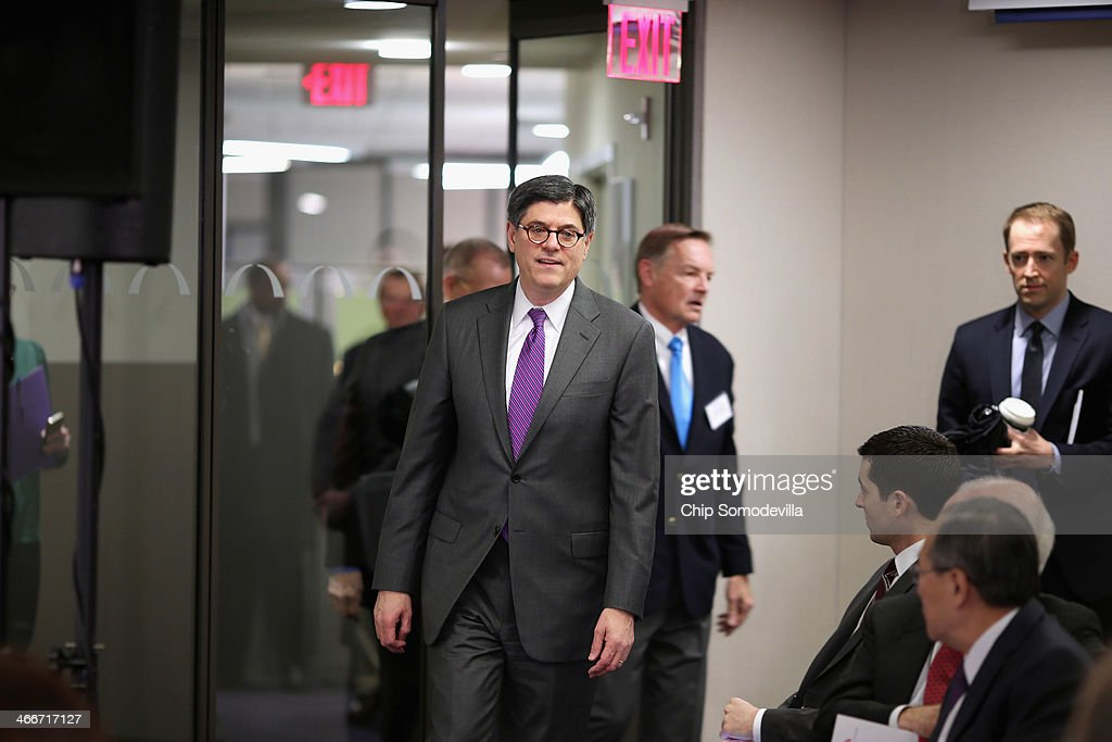 Treasury Secretary Jacob Lew (C) arrives to deliver keynote remarks and answers questions during an event about the federal debt limit at the Bipartisan Policy Center February 3, 2014 in Washington, DC. Lew urged the Congress to raise the debt limit, saying that the Treasury will have to use special steps to continue selling debt if the ceiling is not raised by February 7.