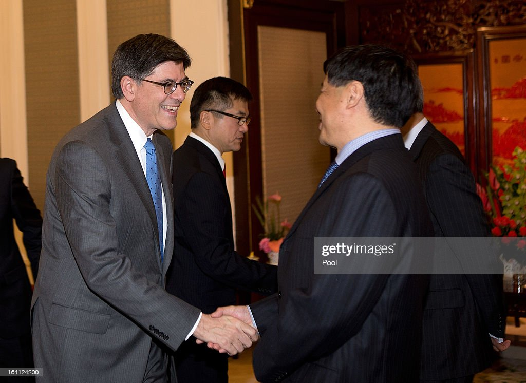 U.S. Treasury Secretary Jacob Lew, left, and U.S. Ambassador to China Gary Locke, center, are greeted by Chinese government officials before a meeting with Chinese Premier Li Keqiang at the Zhongnanhai diplomatic compound on March 20, 2013 in Beijing, China. The U.S. Treasury Secretary is in China for wide-ranging talks with Chinese President Xi Jinping and Chinese Premier Li Keqiang over the global economy, the exchange rate, trade, cyber-security and North Korea's nuclear programme. US Treasury secretary Jacob Lew met with the newly-elected President of China on Tuesday, Xi Jinping's first meeting with a foreign official since being appointed.