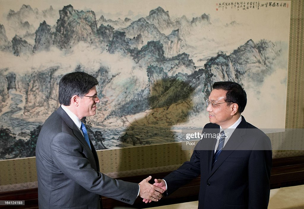 U.S. Treasury Secretary Jacob Lew, left, is greeted by Chinese Premier <a gi-track='captionPersonalityLinkClicked' href=/galleries/search?phrase=Li+Keqiang&family=editorial&specificpeople=2481781 ng-click='$event.stopPropagation()'>Li Keqiang</a> upon his arrival at the Zhongnanhai diplomatic compound on March 20, 2013 in Beijing, China. The U.S. Treasury Secretary is in China for wide-ranging talks with Chinese President Xi Jinping and Chinese Premier <a gi-track='captionPersonalityLinkClicked' href=/galleries/search?phrase=Li+Keqiang&family=editorial&specificpeople=2481781 ng-click='$event.stopPropagation()'>Li Keqiang</a> over the global economy, the exchange rate, trade, cyber-security and North Korea's nuclear programme. US Treasury secretary Jacob Lew met with the newly-elected President of China on Tuesday, Xi Jinping's first meeting with a foreign official since being appointed.