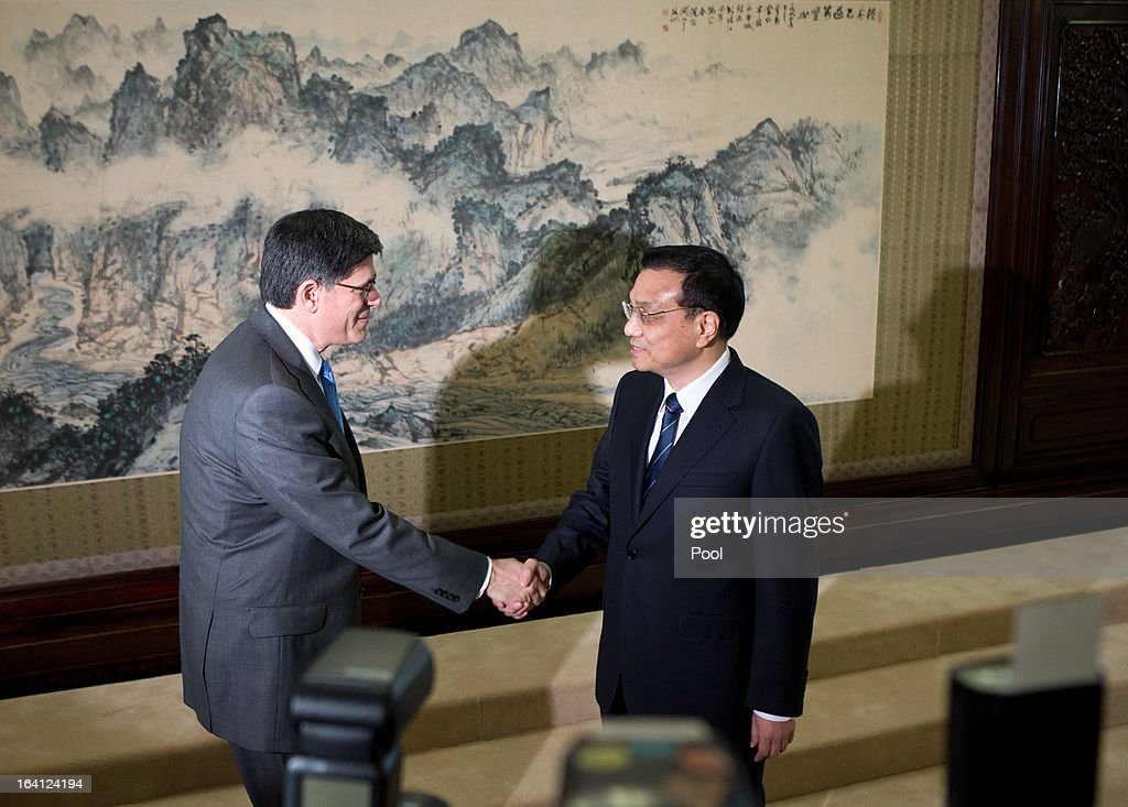 U.S. Treasury Secretary Jacob Lew, left, is greeted by Chinese Premier Li Keqiang upon his arrival at the Zhongnanhai diplomatic compound on March 20, 2013 in Beijing, China. The U.S. Treasury Secretary is in China for wide-ranging talks with Chinese President Xi Jinping and Chinese Premier Li Keqiang over the global economy, the exchange rate, trade, cyber-security and North Korea's nuclear programme. US Treasury secretary Jacob Lew met with the newly-elected President of China on Tuesday, Xi Jinping's first meeting with a foreign official since being appointed.