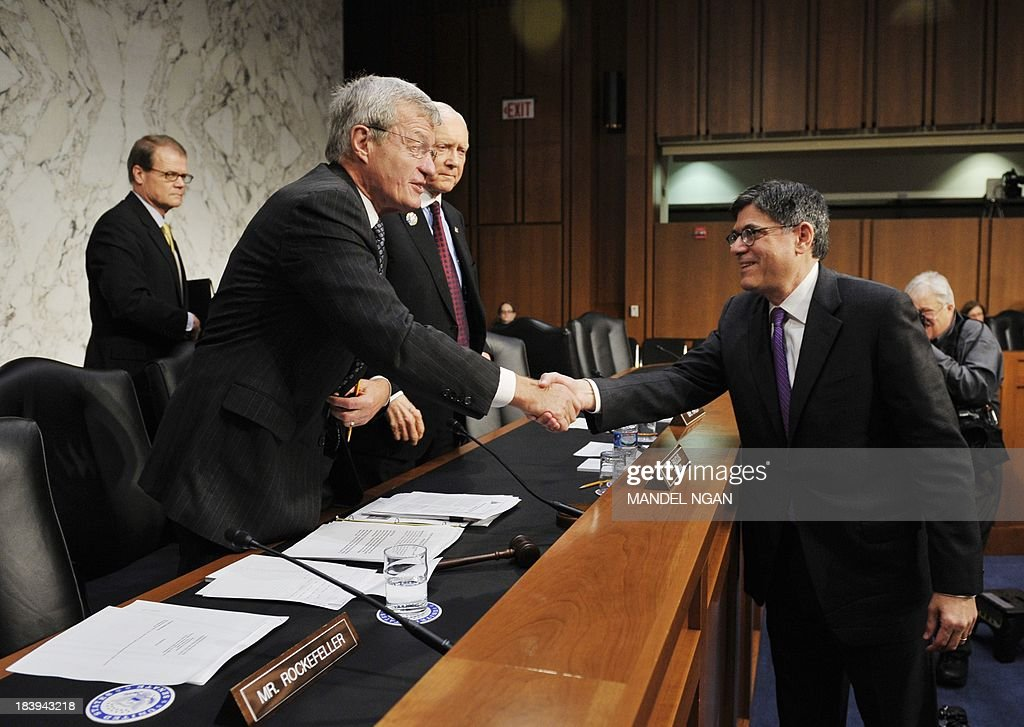 US Treasury Secretary Jacob Lew (R) shakes hands wint Senate Finance Committee Chairman Max Baucus (L), D-MT, as Ranking Member Orrin Hatch (2nd L), R-UT, watches after testifying to the Committee on the debt limit in the Hart Senate Office Building on Capitol Hill in Washington, DC on October 10, 2013. A US debt default would cause serious economic repercussions, including 'deeply damaging' financial markets, Lew warned lawmakers Thursday a week before a deadline to raise the US borrowing limit. 'If Congress fails to meet its responsibility, it could be deeply damaging to the financial markets, the ongoing economic recovery, and the jobs and savings of millions of Americans,' Lew testified. 'If Congress does not act and the US suddenly cannot pay its bills, the repercussions would be serious.' AFP PHOTO/Mandel NGAN