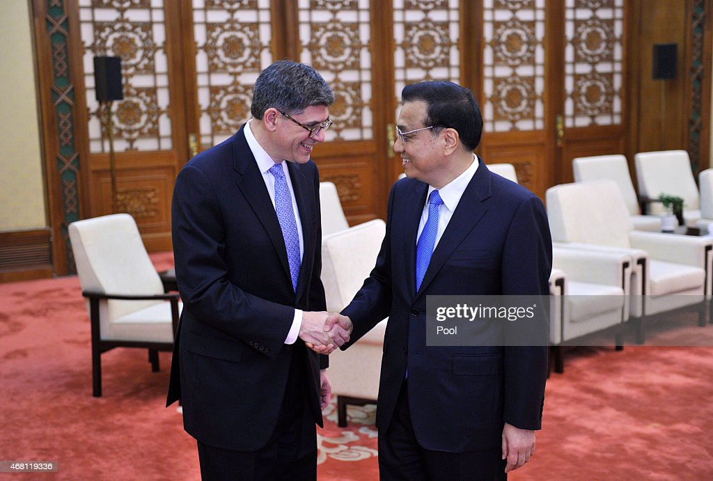 U.S. Treasury Secretary Jacob Lew (left) shakes hands with Chinese Premier <a gi-track='captionPersonalityLinkClicked' href=/galleries/search?phrase=Li+Keqiang&family=editorial&specificpeople=2481781 ng-click='$event.stopPropagation()'>Li Keqiang</a> before a meeting at the Great Hall of the People on March 30, 2015 in Beijing, China. Lew was noted to be speaking on foreign security technology while in Beijing.