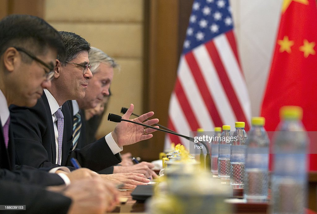 U.S. Treasury Secretary Jacob Lew (2nd-L) speaks during a meeting with Vice Premier Wang Yang of China at the Diaoyutai State Guesthouse on November 15, 2013 in Beijing, China.