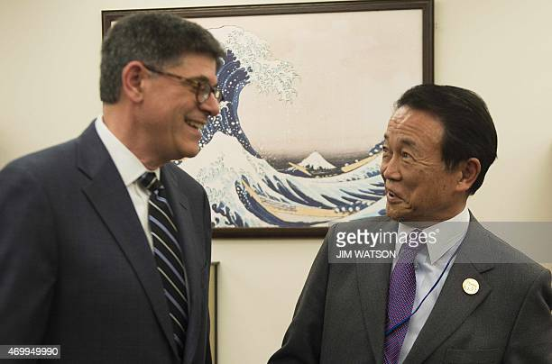 US Treasury Secretary Jacob Lew talks with Japanese Finance Minister Taro Aso before a bilateral meeting during the IMF/World Bank Springh Meetings...
