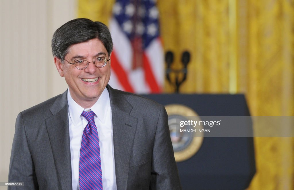 US Treasury Secretary Jacob Lew walks across the East Room to greet guests before the start of a nomination ceremony on March 4, 2013 in the East Room of the White House in Washington, DC. AFP PHOTO/Mandel NGAN