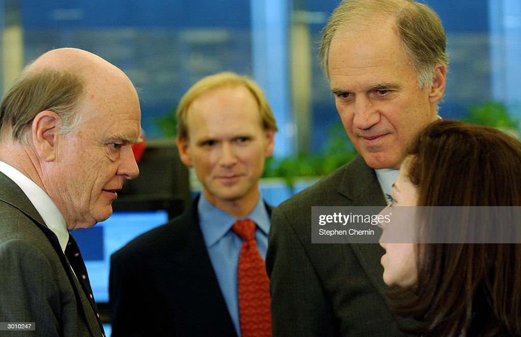 U.S. Treasury Secretary John Snow (L) speaks with Claudia Jury (R), JP Morgan foreign exchange vice president, as JP Morgan Chairman William Harrison Jr. (R) and Even Berntsen (2nd L), with the JP Morgan foreign exchange desk, listen on the JP Morgan trading floor February 24, 2004 in New York City. Snow said the U.S. economy is performing well and said a team of U.S. Treasury officials is heading to China to address currency exchange rates there.