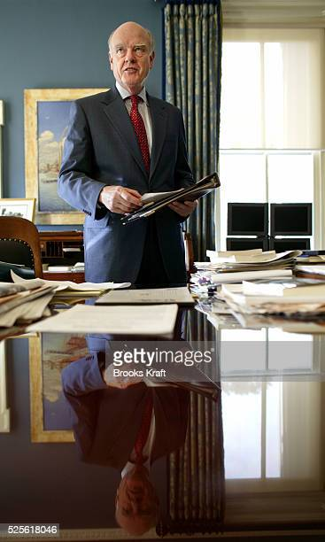 Treasury Secretary John Snow stands in his Washington DC office