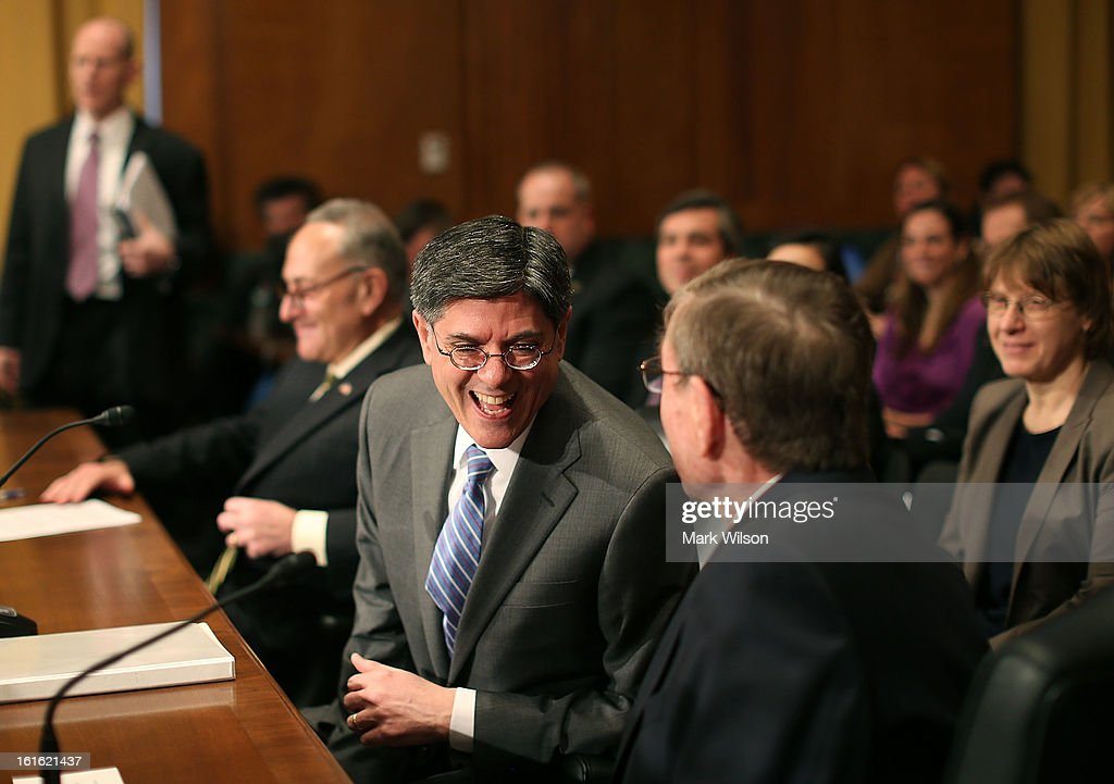 Treasury Secretary nominee Jack Lew (C) shares a laugh with former U.S. Sen. Pete V. Domenici (R-NM)(R), during his Senate Finance Committee confirmation hearing, February 13, 2013 in Washington, DC. If confirmed by the U.S. Senate Mr. Lew will replace Tim GeithnerÊas Treasury Secretary.