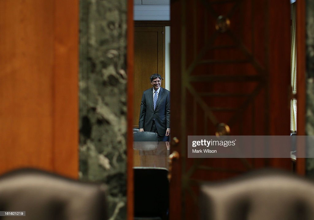Treasury Secretary nominee Jack Lew stands in the back room of he Senate Finance Committee before the start of his confirmation hearing, February 13, 2013 in Washington, DC. If confirmed by the U.S. Senate Mr. Lew will replace Tim Geithner as Treasury Secretary.