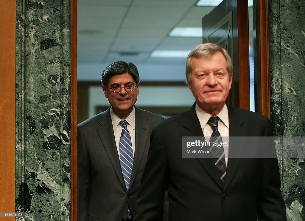 Treasury Secretary nominee Jack Lew (L) walks into his Senate Finance Committee confirmation hearing with Chairman Max Baucus (D-MT), February 13, 2013 in Washington, DC. If confirmed by the U.S. Senate Mr. Lew will replace Tim Geithner as Treasury Secretary.