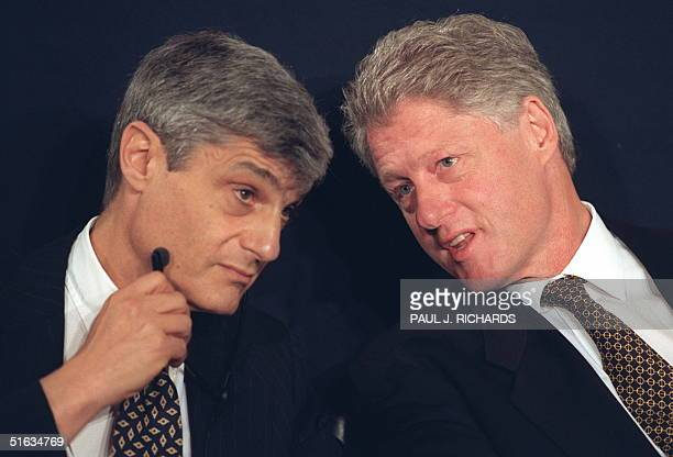 Treasury Secretary Robert Rubin listens to US President Bill Clinton during the opening ceremonies of the annual Meetings of the Board of Governors...