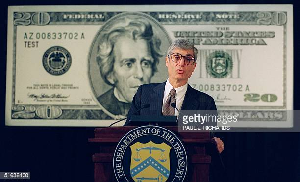 Treasury Secretary Robert Rubin speaks during a press conference while standing in front of a poster of the new 20 USD bill 24 September at the...