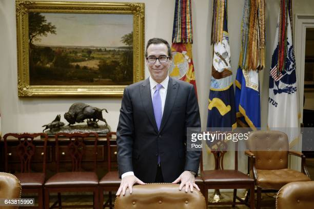 Treasury Secretary Steve Mnuchin attends a meeting with President Donald Trump in the Roosevelt Room of the White House on February 22 2017 in...