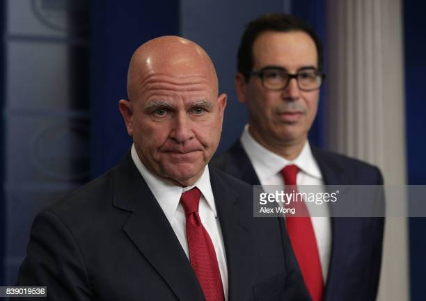 S Treasury Secretary Steven Mnuchin and National Security Adviser HR McMaster speak to members of the White House press corps during a daily briefing...