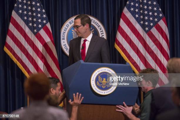 S Treasury Secretary Steven Mnuchin looks aside as workers remove the podium after he finished remarks at the Ronald Reagan Presidential Library...
