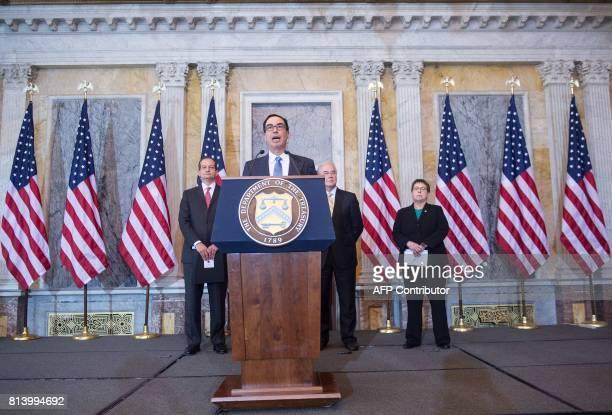 US Treasury Secretary Steven Mnuchin speaks as Labor Secretary Alexander Acosta Health and Human Services Secretary Tom Price and Social Security...