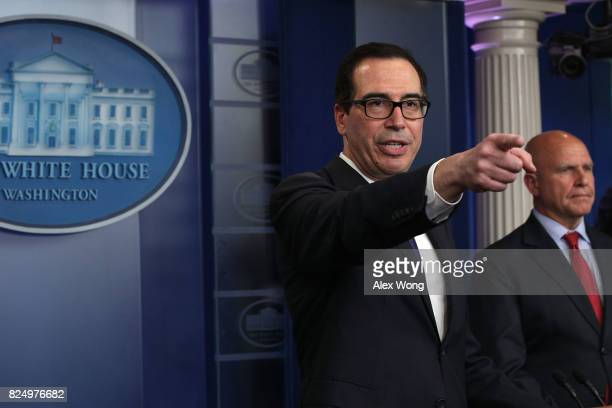 S Treasury Secretary Steven Mnuchin takes questions as National Security Adviser HR McMaster looks on during a daily briefing at the James Brady...