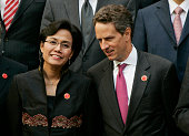 Treasury Secretary Tim Geithner talks to Indonesian Finance Minister Sri Mulyani Indrawati during a group picture at the G20 finance Minister's...
