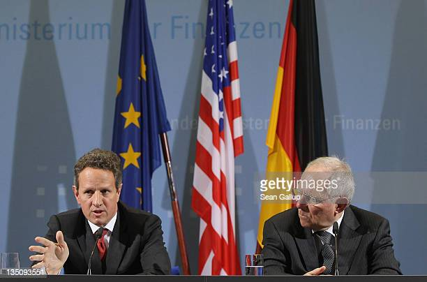 S Treasury Secretary Timothy Geithner and German Finance Minister Wolfgang Schaeuble speak to the media after talks on December 6 2011 in Berlin...