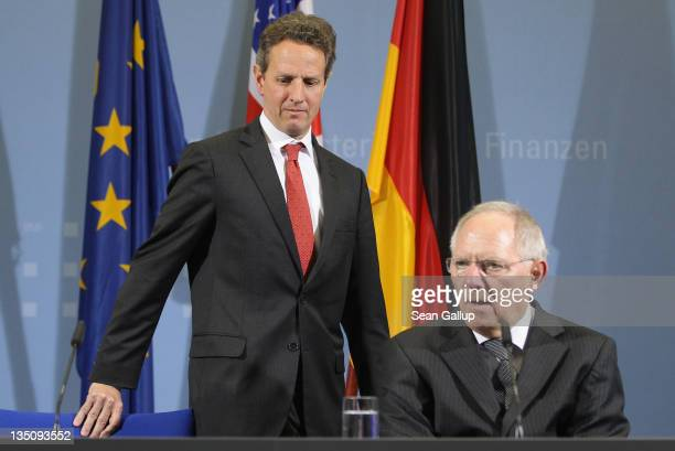 S Treasury Secretary Timothy Geithner and German Finance Minister Wolfgang Schaeuble arrive to speak to the media after talks on December 6 2011 in...