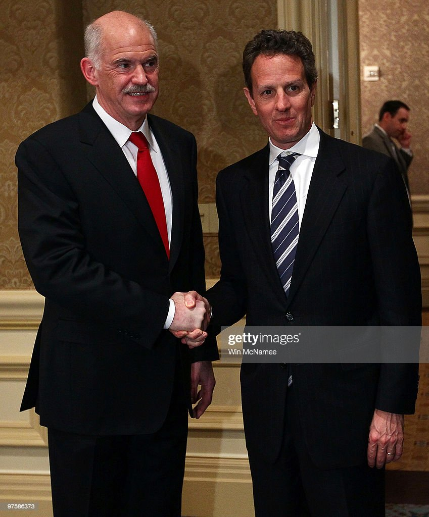 U.S. Treasury Secretary <a gi-track='captionPersonalityLinkClicked' href=/galleries/search?phrase=Timothy+Geithner&family=editorial&specificpeople=5087853 ng-click='$event.stopPropagation()'>Timothy Geithner</a> (R) and Greek Prime Minister <a gi-track='captionPersonalityLinkClicked' href=/galleries/search?phrase=George+Papandreou&family=editorial&specificpeople=212855 ng-click='$event.stopPropagation()'>George Papandreou</a> shake hands before meeting March 9, 2010 in Washington, DC. Geithner and Papandreou were expected to discuss economic conditions in both nations during their meeting.