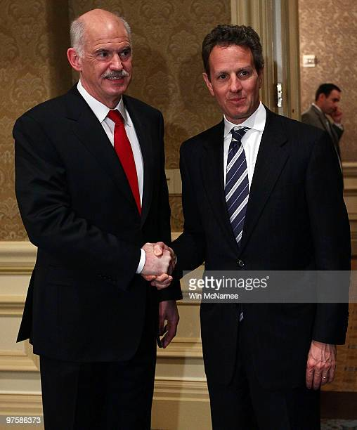 S Treasury Secretary Timothy Geithner and Greek Prime Minister George Papandreou shake hands before meeting March 9 2010 in Washington DC Geithner...