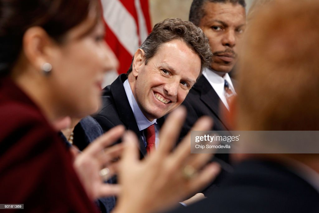 Treasury Secretary Timothy Geithner listens to Landmark Technology President and CEO Lani Hay deliver remarks during a small business forum at the...