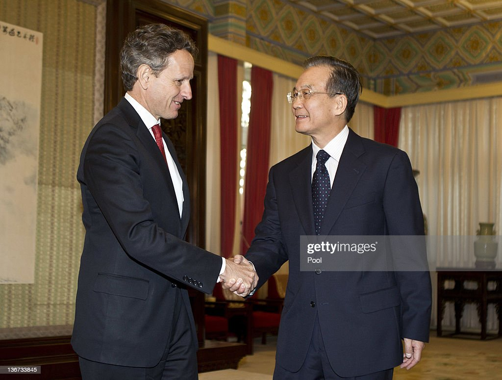Treasury Secretary Timothy Geithner shakes hands with Chinese Premier Wen Jiabao ahead of a meeting at the Zhongnanhai Purple Pavilion on January 11...