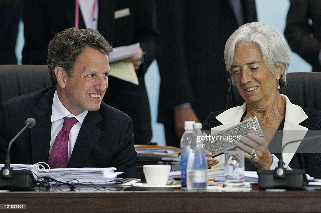 US Treasury Secretary Timothy Geithner (L) smiles as he looks at souvenirs while chatting with French Finance Minister Christine Lagarde during a break at the G20 Finance Ministers and Central Bank Governors Meeting in Busan on June 5, 2010. Finance ministers from the world's leading nations sought to narrow differences on key banking reforms, wrapping up a two-day meeting aimed at safeguarding fragile economic recovery.