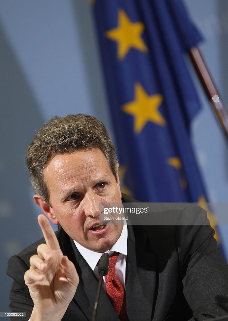 S Treasury Secretary Timothy Geithner speaks to the media in front of a flag of the European Union after talks with German Finance Minister Wolfgang...