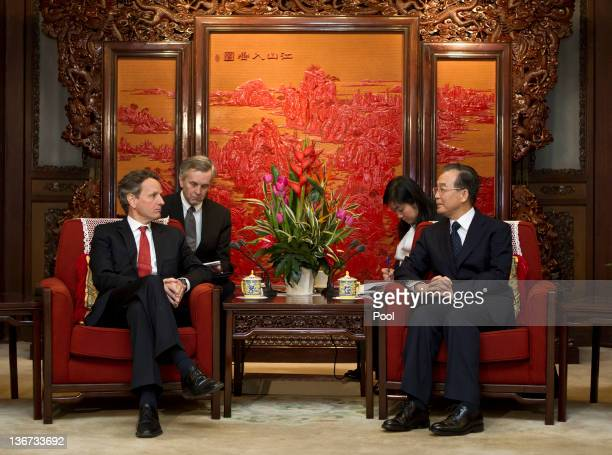 Treasury Secretary Timothy Geithner speaks with Chinese Premier Wen Jiabao during a meeting at the Zhongnanhai Purple Pavilion on January 11 2012 in...