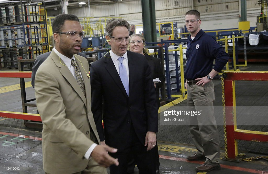 S Treasury Secretary Timothy Geithner speaks with US Rep Jesse Jackson Jr while touring Ford Motor Company's Chicago Stamping Plant as plant manager...