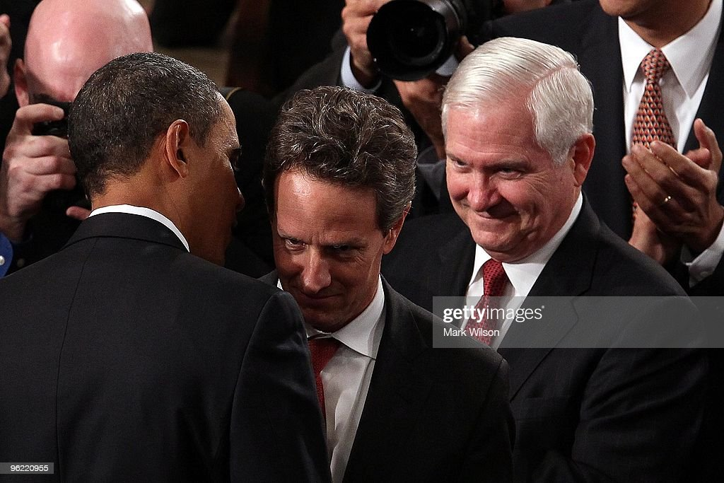 Treasury Secretary <a gi-track='captionPersonalityLinkClicked' href=/galleries/search?phrase=Timothy+Geithner&family=editorial&specificpeople=5087853 ng-click='$event.stopPropagation()'>Timothy Geithner</a>is greeted by U.S. President <a gi-track='captionPersonalityLinkClicked' href=/galleries/search?phrase=Barack+Obama&family=editorial&specificpeople=203260 ng-click='$event.stopPropagation()'>Barack Obama</a> prior to his speech to both houses of Congress as Robert Gates looks on during his first State of the Union address at the U.S. Capitol on January 27, 2010 in Washington, DC. Since taking office a little over a year ago, Obama's approval ratings have dropped significantly according to recent polls.