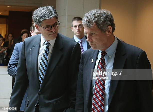 Treasury Secretery Jack Lew walks with Sen Sherrod Brown as they walk to a meeting on Capitol Hill April 14 2015 in Washington DC Secretary Lew...
