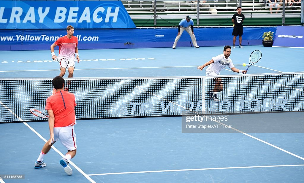 Treat Huey of Philippines and Max Mirnyi of Belarus in action defeating Chris Guccione and Bernard Tomic of Australia at the Delray Beach Open at Delray Beach Stadium & Tennis Center on February 18, 2016 in Delray Beach, Florida.