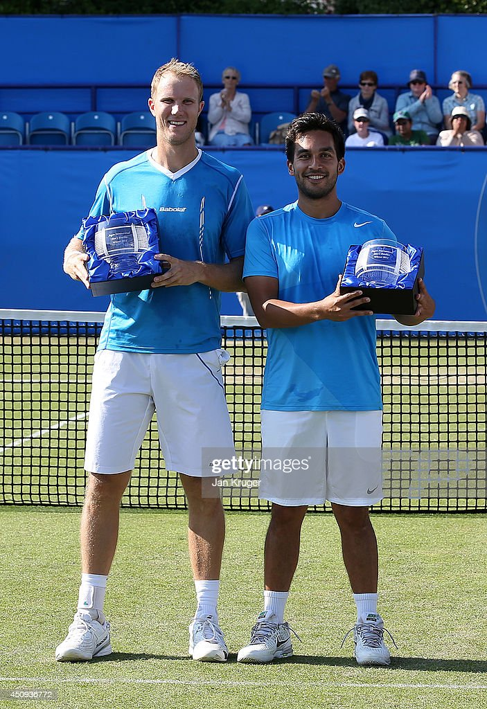 Treat Huey of Phillippines and Dominic Inglot of Great Britain pose with their winners trophies on day seven of the Aegon International at Devonshire...
