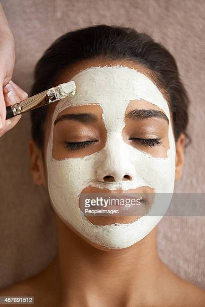Treating herself to a luxurious facial mask