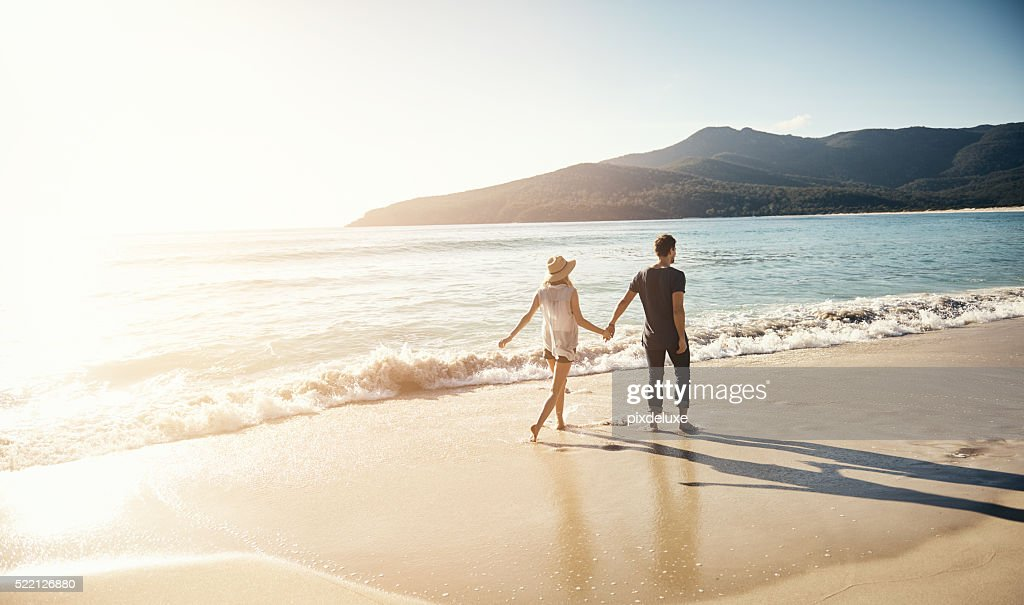 Treating themselves to a beachside vacation : Stock Photo