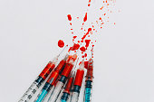 Treatment against addiction. Syringe with blood. Immunodeficiency. Treatment of addiction